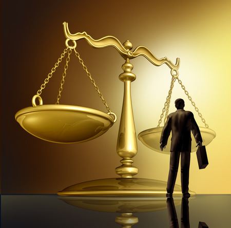 lawyer and the law with a justice scale made of brass gold metal on a glowing