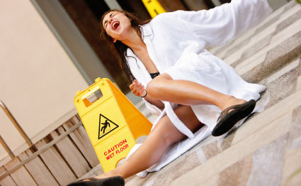 Young woman falling on wet floor